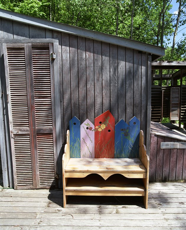 Decorative wooden bench on porch