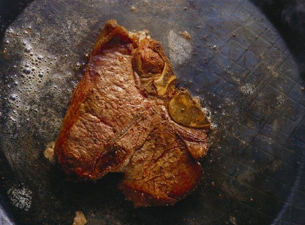 Porterhouse Steak frying in Butter