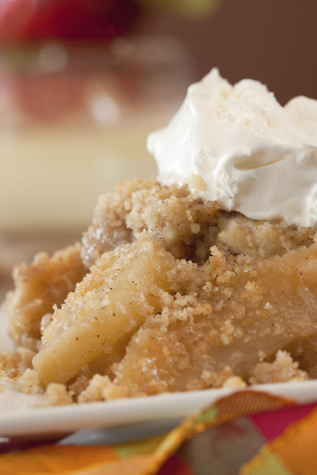 Dish Of Apple Crisp with Whipped Cream Topping
