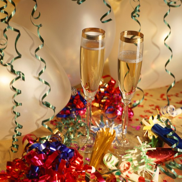 Champagne flutes, streamers and noisemakers