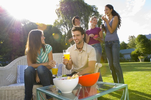 Friends snacking outdoors