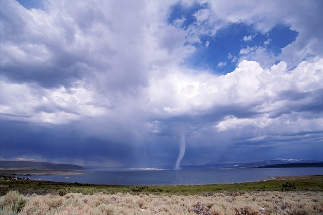 Tornado over desert lake