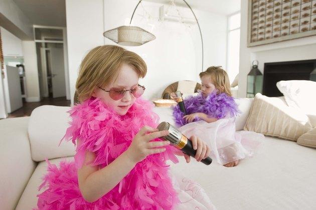 Twin girls playing dress-up