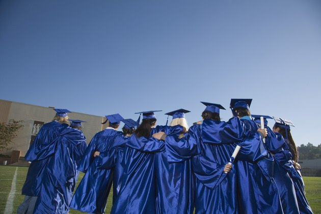 Back view of teenagers wearing cap and gowns