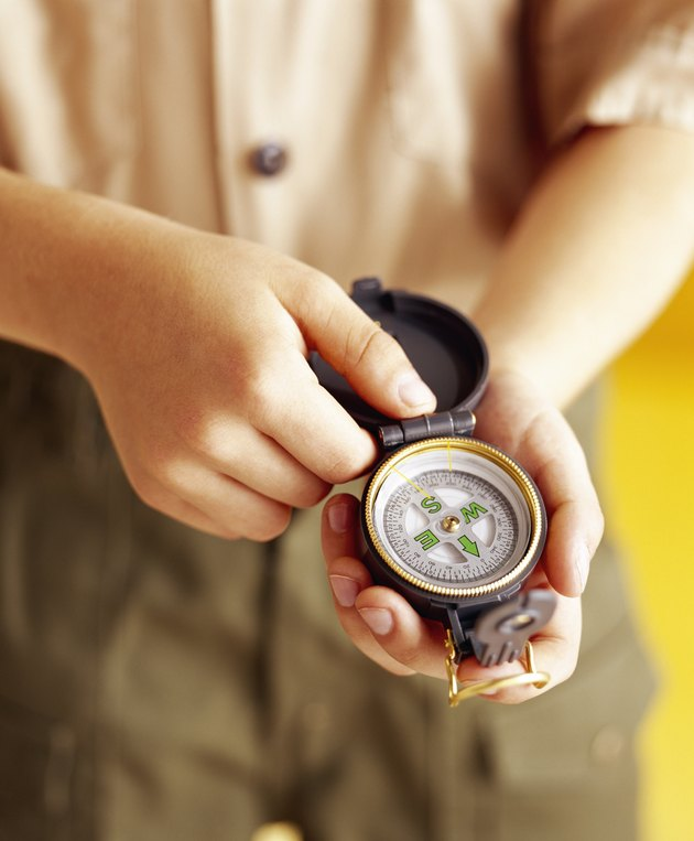 Boy scout with compass