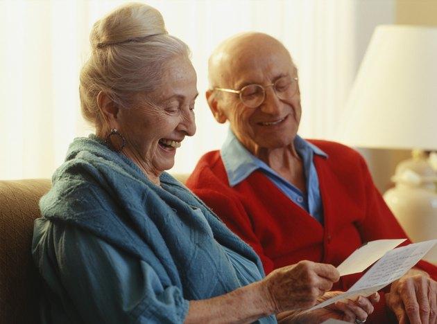 Elderly couple reading letter