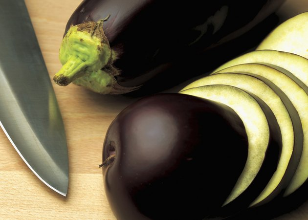 close-up of sliced aubergine with a knife