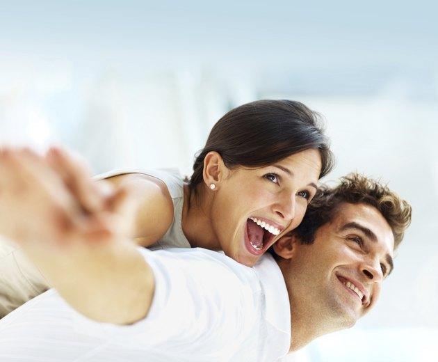 Smiling young couple having fun