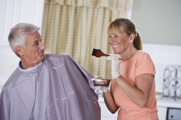 Woman with hair dye for man