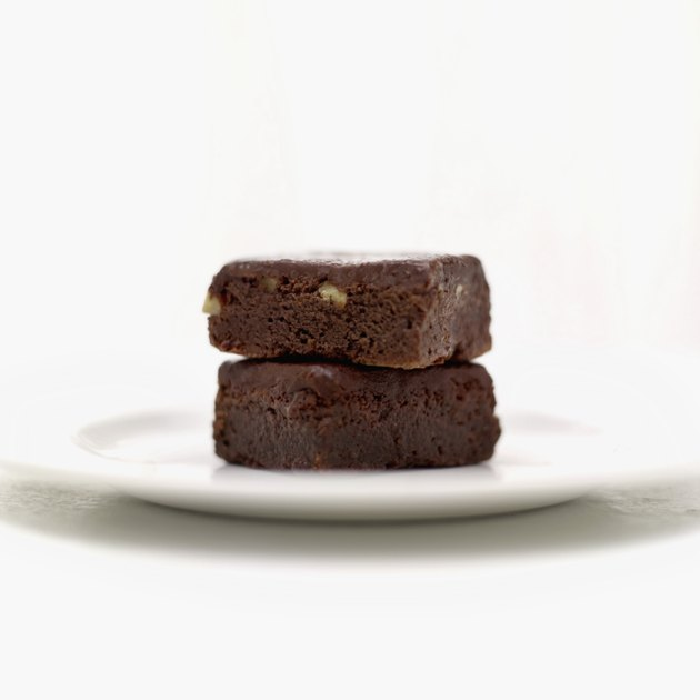 Close-up of a pile of two chocolate brownies on a plate