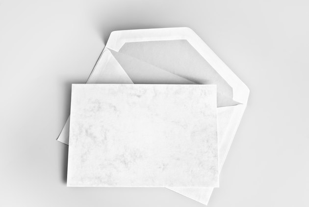 Blank card and envelope over gray background