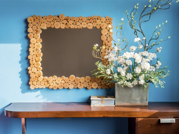 Colourful modern interior wall with artificial flowers in cerami
