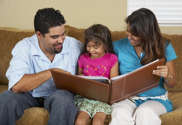 Hispanic family looking at photo album