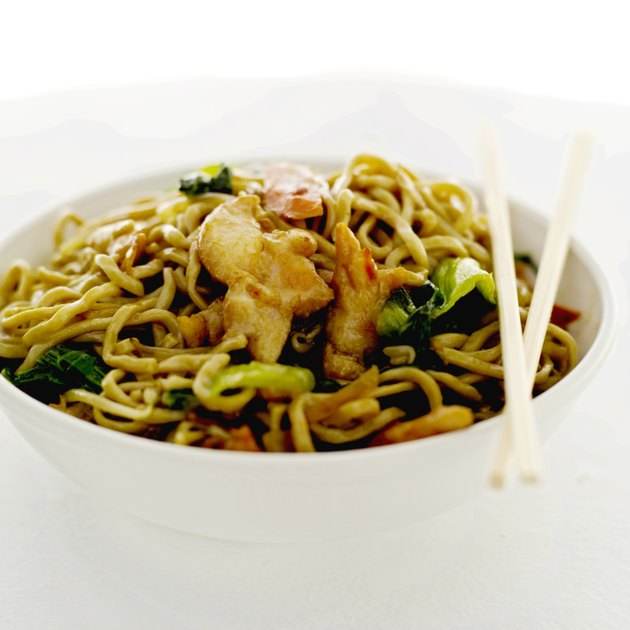 close-up of chinese noodles in a bowl and a pair of chopsticks