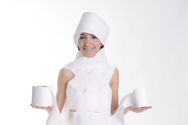 young women wrapped up economical toilet paper