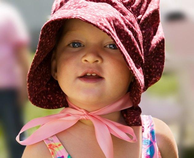 Portrait of little girl in 'pioneer' bonnet