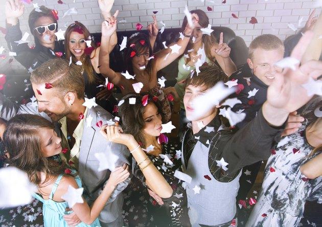 Group of people dancing in a bar or nightclub