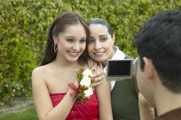 Father Filming Mother and Daughter With a Digital Camcorder, Daughter Dressed for Her High School Prom
