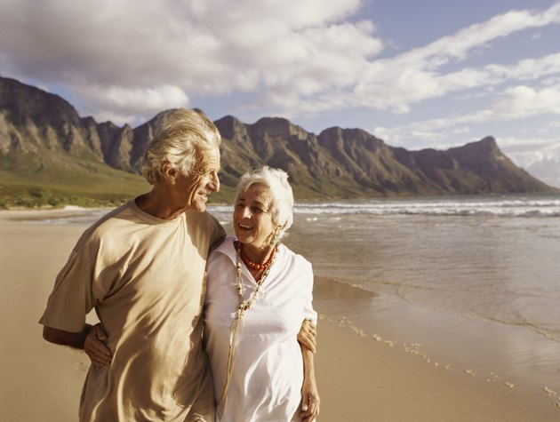 Senior Couple Walking Along a Beach