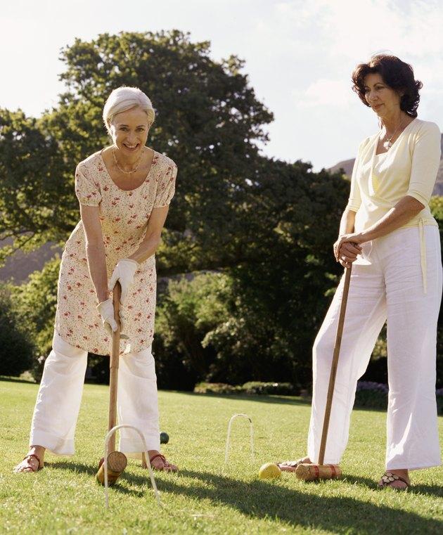 Senior Female Friends Playing Croquet