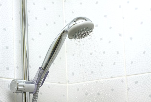 Shower in bathroom with running water down