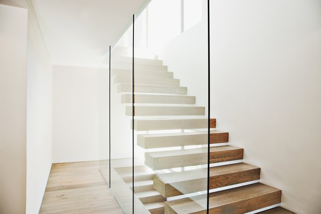 Floating staircase and glass walls in modern house