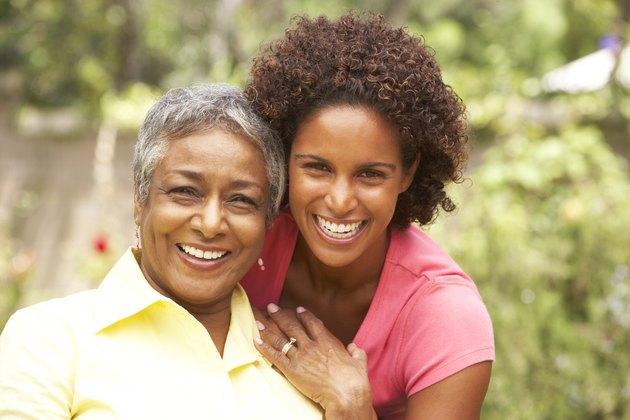 Senior Woman Hugging Adult Daughter