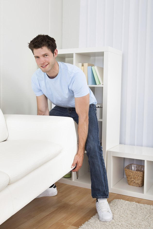 Man Lifting Couch