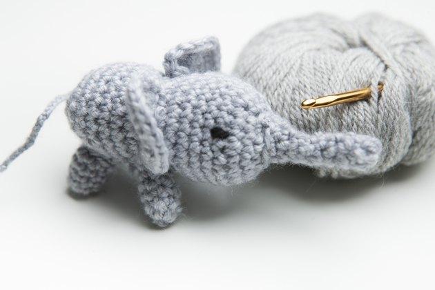 Hand crocheted elephant with wool, crochet needle