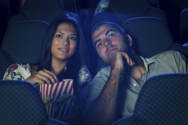 Couple watching movie in cinema