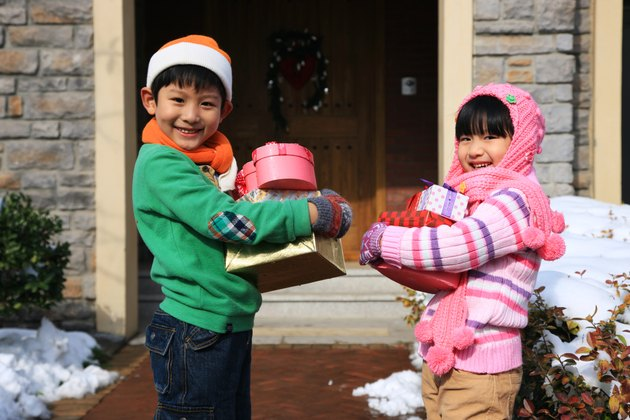 Children holding gift boxes