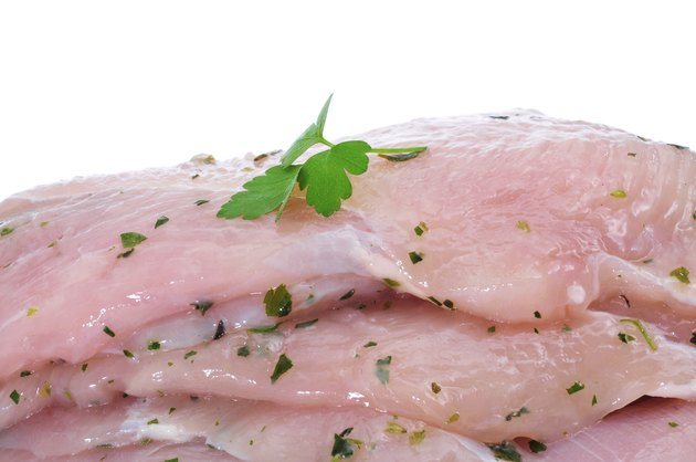 raw chicken meat marinated with parsley and olive oil