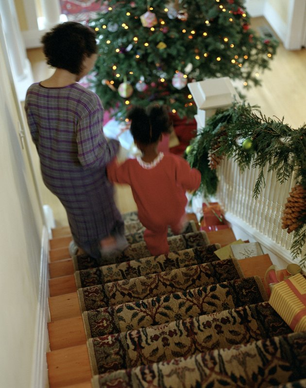Mother and Daughter Walking Down Stairs on Christmas Morning