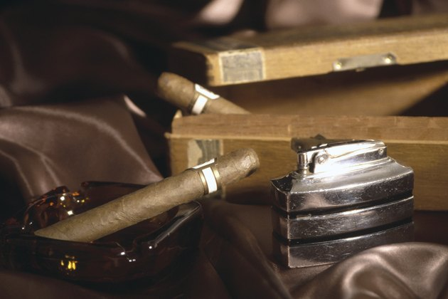 Cigars with lighter and ash tray