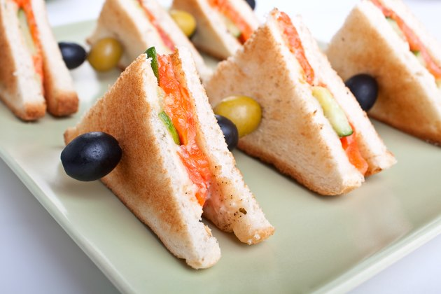 club sandwiches with salmon and cucumbers