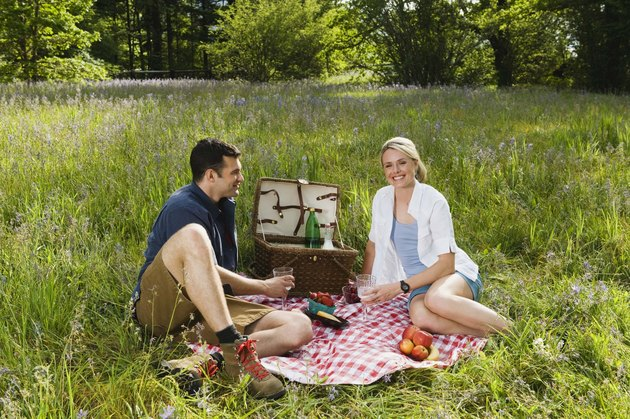Couple having picnic in field