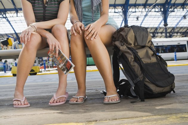 Women sitting on bench at train station