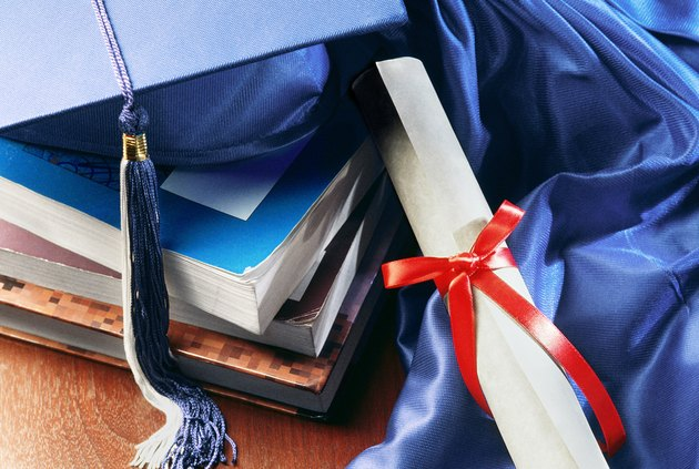 Diploma, tassel and books
