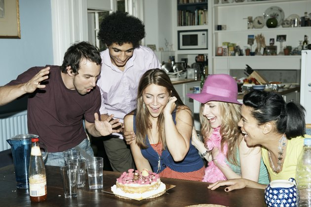 Group of friends admiring cake