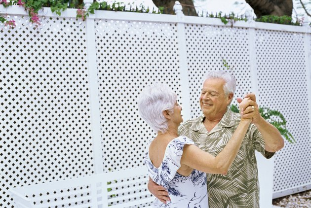 Side view of a senior couple dancing