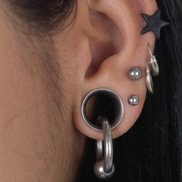Extreme close-up of person's pierced ear