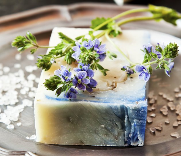 Decorate homemade soap with dried lavender sprigs before giving it as gifts.