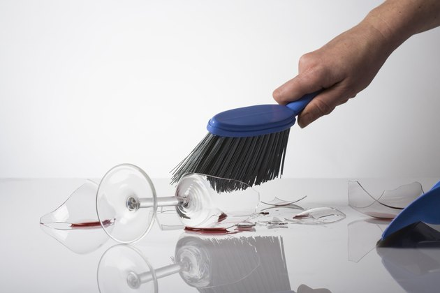 Person cleaning up broken glass