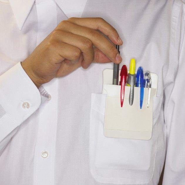 Man placing pen in shirt pocket