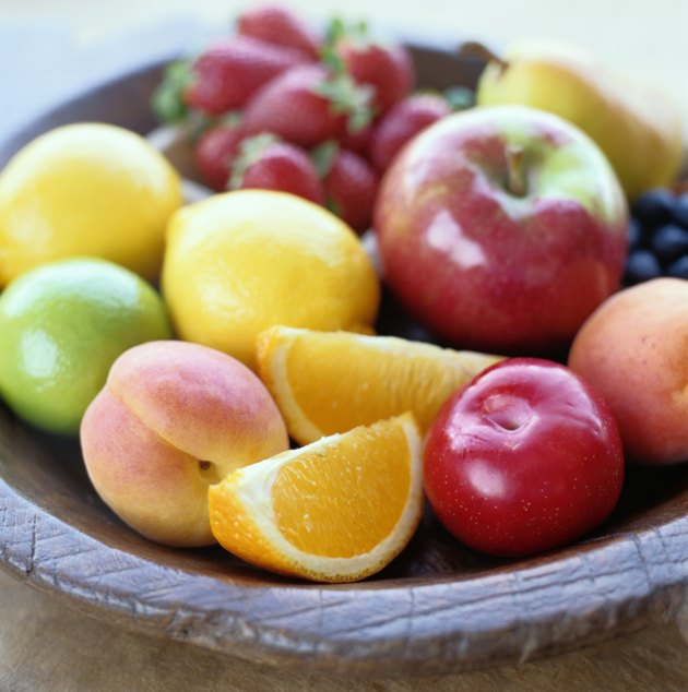 Variety of fruits in a wooden bowl
