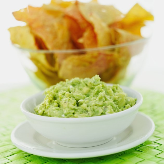 close-up of a bowl of nachos with dip