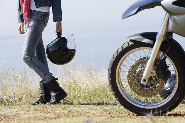 Woman motorcyclist on countryside