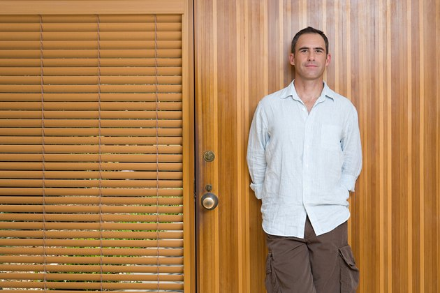 Man leaning on front door