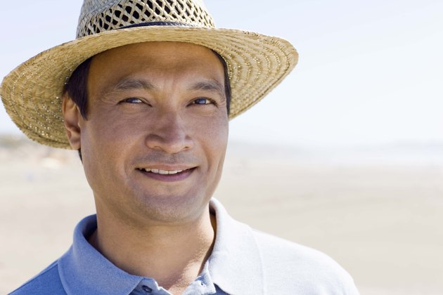 Portrait of man in straw hat