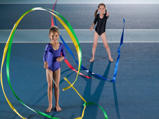 Girls doing rhythmic gymnastics